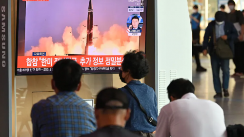 Group watching rocket launch