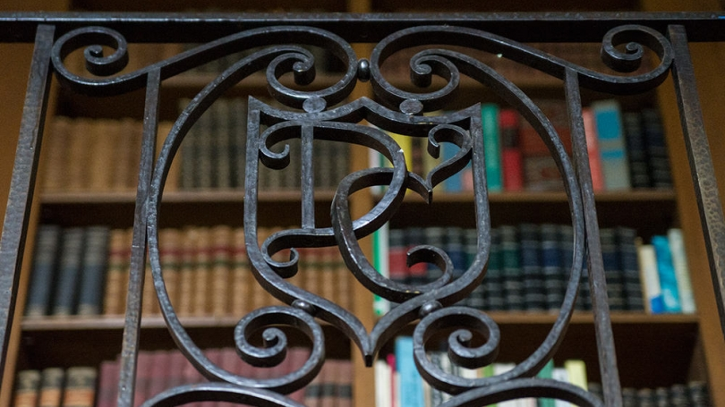 """A detail of ironwork with a """"D"""" and a """"C"""""""