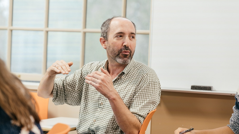 Professor Michael Herron talks with students during a class in the quantitative social sciences program in 2017.
