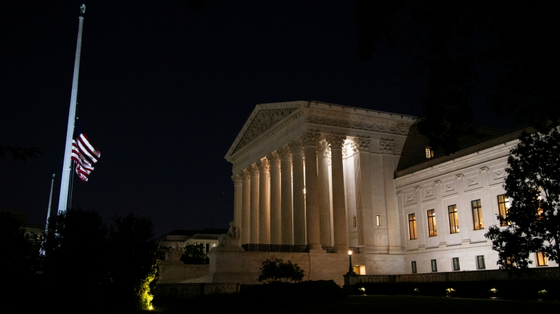The flag outside the U.S. Supreme Court building flies at half-staff in honor of Justice Ruth Bader Ginsburg.