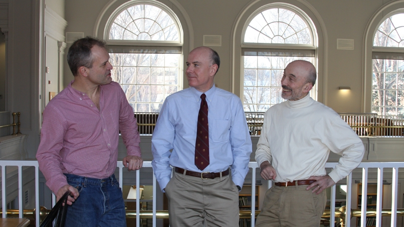 From left, Russell Muirhead, Doug Irwin, and Meir Kohn discuss the Political Economy Project,